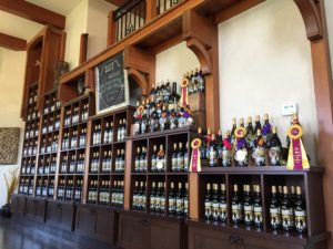 the shelves of Moon Curser Vineyards tasting room also showcasing their award winning wines