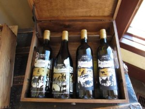 a wooden case containing four bottles of Moon Curser Vineyards wines